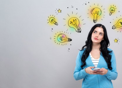 Idea light bulbs with woman holding a smartphone